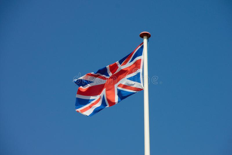 Union Jack, battement BRITANNIQUE de drapeau dans le vent photo stock