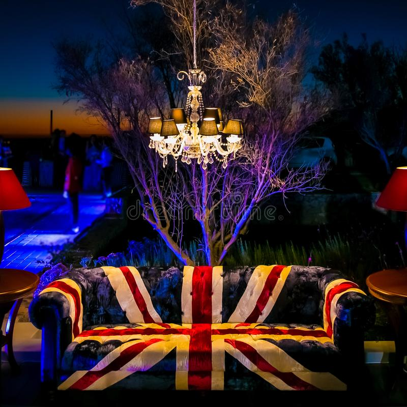 Union Jack British Flag couch and chandelier at outdoor corporate event stock photography