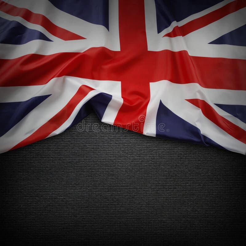 Union Jack flag. On dark background royalty free stock photos