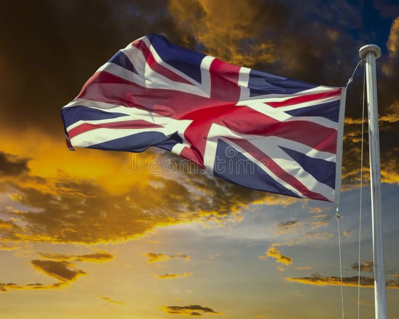 Download Union Jack On Flagpole Under Dark Brooding Sky. Stock Image - Image: 25470499
