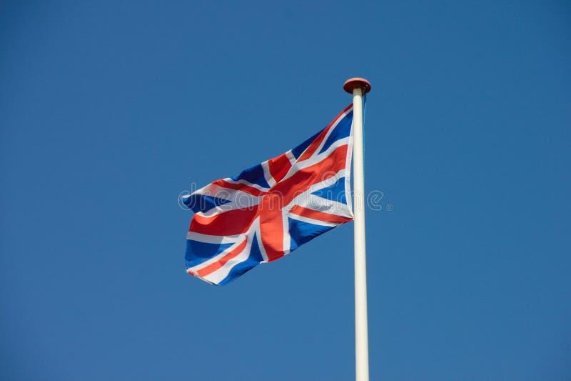 Union Jack, sbattimento BRITANNICO della bandiera nel vento fotografia stock