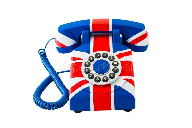 Union Jack-telefoon met patroon van de vlag van Groot-Brittannië op witte achtergrond wordt geïsoleerd die royalty-vrije stock fotografie