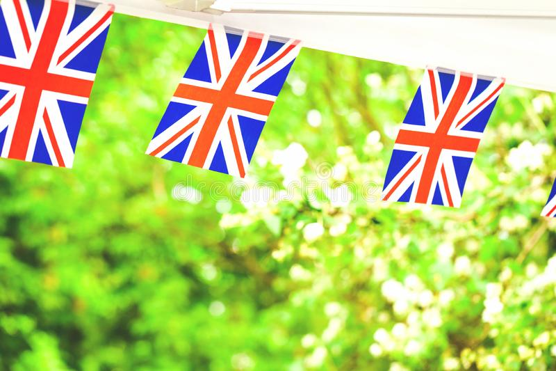 Union- Jackflaggen im Sommergartenfest lizenzfreies stockbild