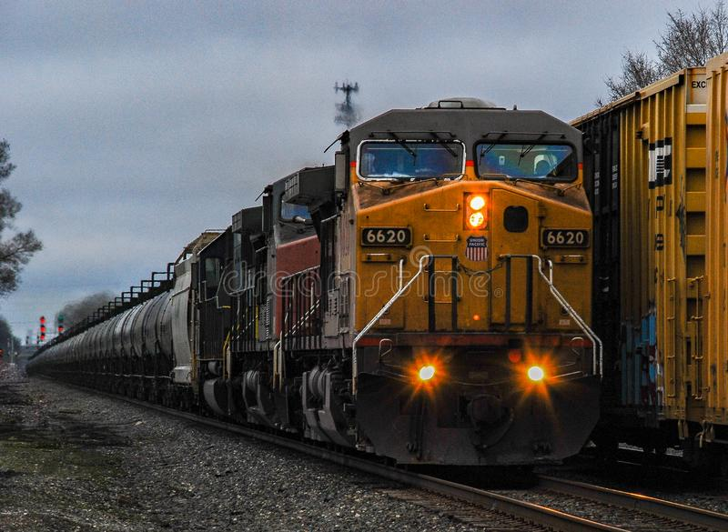 Union Pacific locomotive power pulling a tank car train at dusk. Through Chesterton, Indiana stock photo