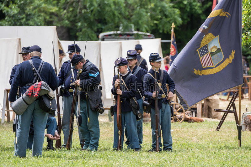 Union Soldiers. Civil War era soldiers prepare equipment at the Dog Island reenactment in Red Bluff, California stock photo