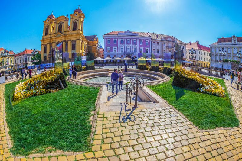 Union Square with floral decoration and tourists in Timisoara, Romania. TIMISOARA, ROMANIA - APRIL 20, 2019: Beautiful floral decoration with the name 10.000 royalty free stock photo