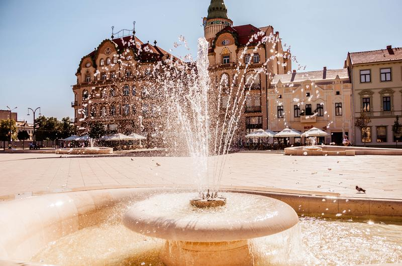 Union square Piata Unirii seen at sunny day in Oradea, Rom. Blue summer .sky. Union square Piata Unirii seen at the rainy day in Oradea, Romania Bihor county royalty free stock image