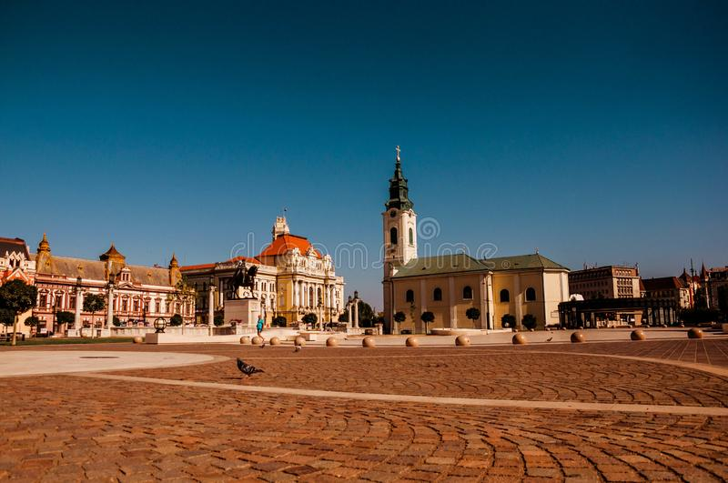Union square Piata Unirii seen at sunny day in Oradea, Rom. Blue summer .sky. Union square Piata Unirii seen at the rainy day in Oradea, Romania Bihor county stock photo