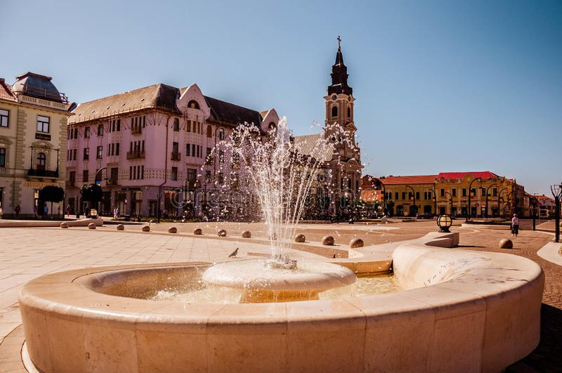 Union square Piata Unirii seen at sunny day in Oradea, Rom. Blue summer .sky. Union square Piata Unirii seen at the rainy day in Oradea, Romania Bihor county stock photography