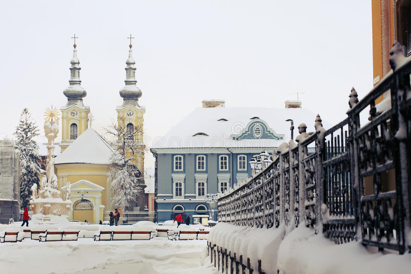 Union Square in Timisoara. The Serbian Episcopal and Serbian Orthodox Church, Union Square in Timisoara at wintertime stock photography