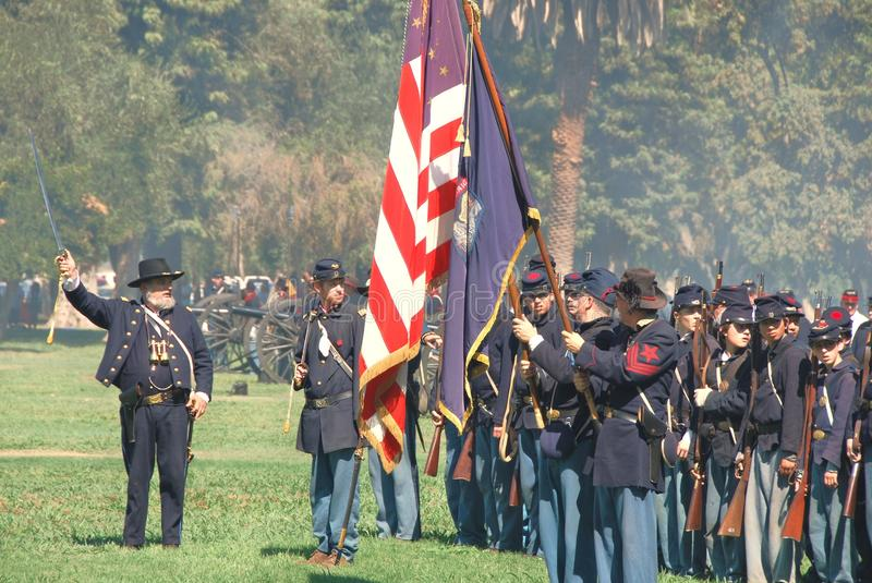 Union troops prepare to fight in the civil war. A group of union soldiers stand ready to march towards the confederate position during the 21st Annual Civil War royalty free stock photography