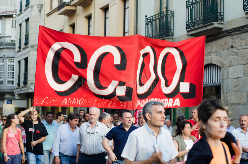 Unions banner. PONTEVEDRA - JULY 19: Detail of the manifestation of all unions and associations to protest the social cuts, of the Conservative government, July stock photo