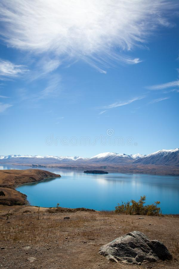 Unique view of New Zealand. Enjoying the large in New Zealand mountains all around me, what a nice view, lake side, New Zealand neuseeland, berge, snow royalty free stock photo