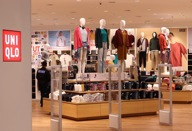 Uniqlo Store At Ipoh. Malaysia. A security personnel is also visible in the picture royalty free stock photography