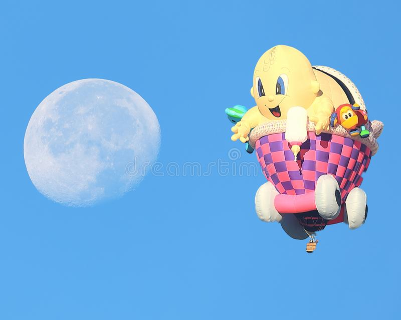 Baby in a carriage balloon reaches for the Moon at Albuquerque stock image