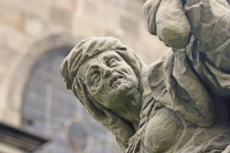 Unique baroque statue depicting avarice stock photo
