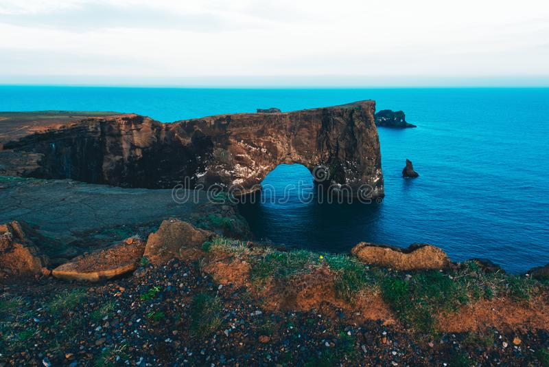 Unique basalt arch on Dyrholaey. Cape. Nature Reserve, Iceland royalty free stock photo