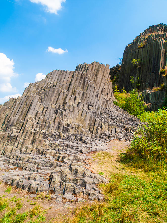 Unique basalt organ pipes of Panska skala near Kamenicky Senov in Northern Bohemia, Czech Republic. Unique basalt organ pipes rock formation of Panska skala near stock photography