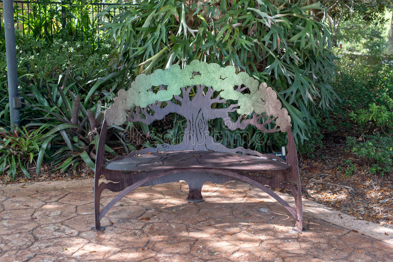 Unique bench in park. Designed as a tree royalty free stock image