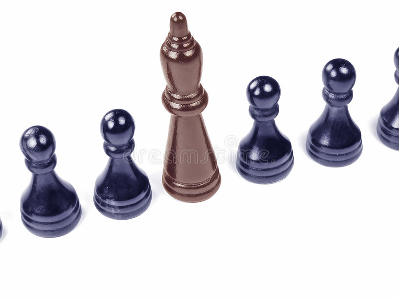 Unique Chess Piece. A standout chess piece amongst the blandness of uniform colored other pieces stock photos