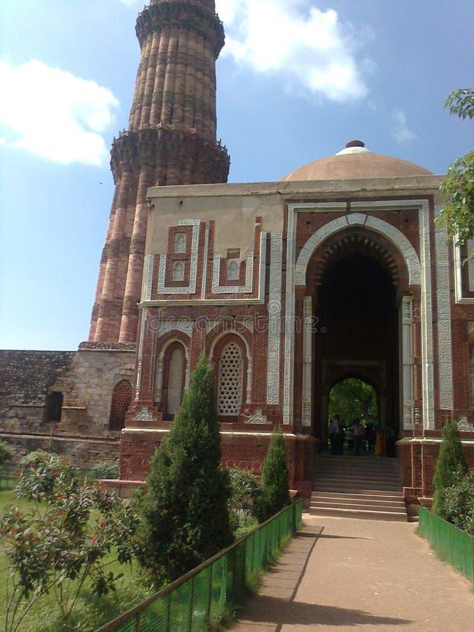 Qutub minar delhi. Unique construction of qutub minnar pillar near other building stock images