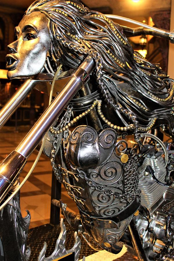 Unique Custom Metal Art Designed Motorcycle. Custom unique metal art designed motorcycle displayed in a hotel casino resort royalty free stock photography