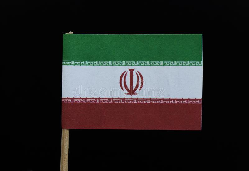 A unique flag of Iran on toothpick on black background. A horizontal tricolor of green, white and red with the national emblem in. Red centred on the white band royalty free stock photography