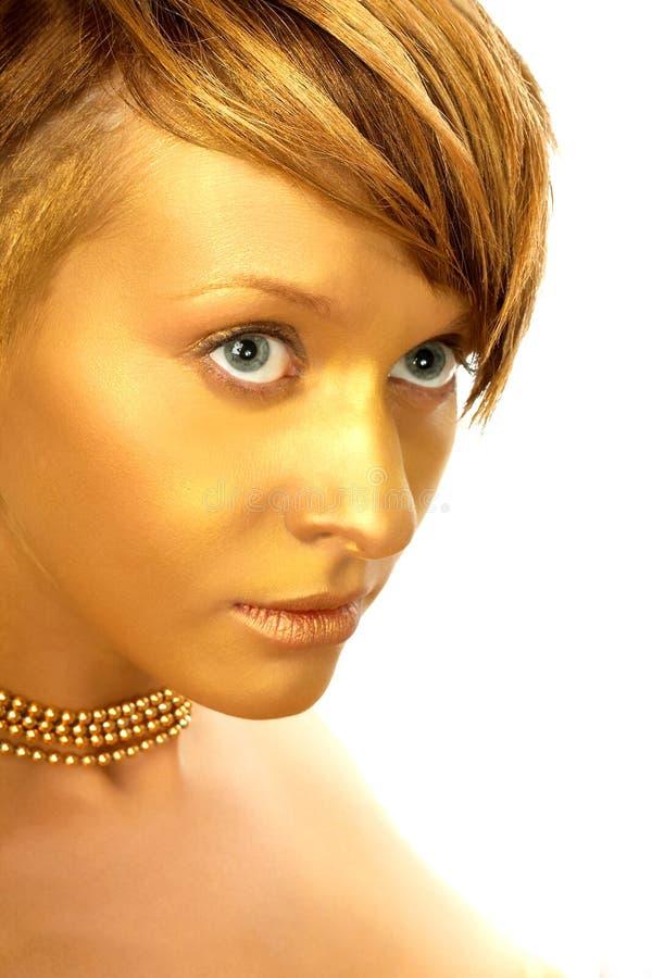 Unique golden lady. Attractive erotic woman with unique golden make-up