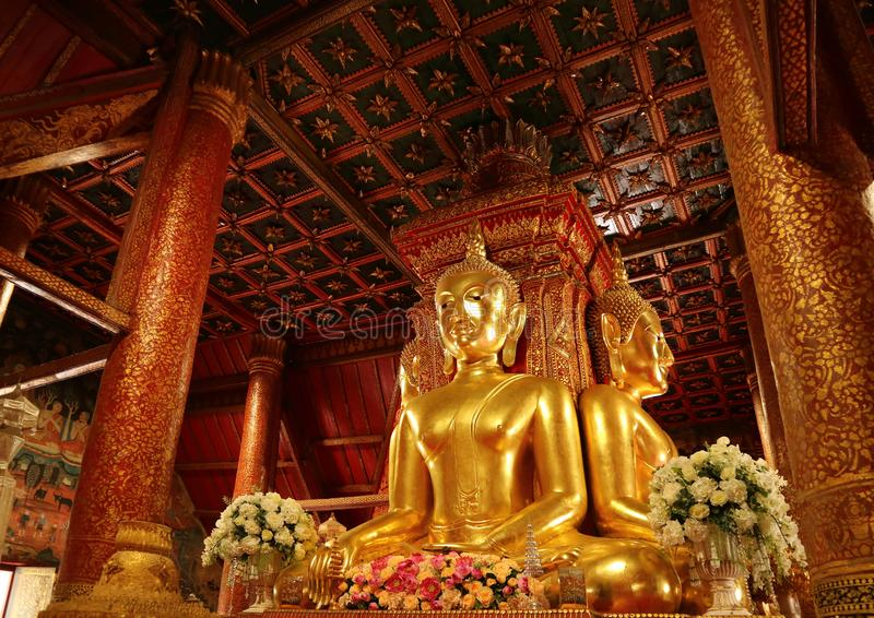 Unique and Gorgeous Golden Four-sided Seated Buddha Images of Wat Phumin Temple, Famous Buddhist Temple in Nan Province, Thailand. Historic Place stock photography