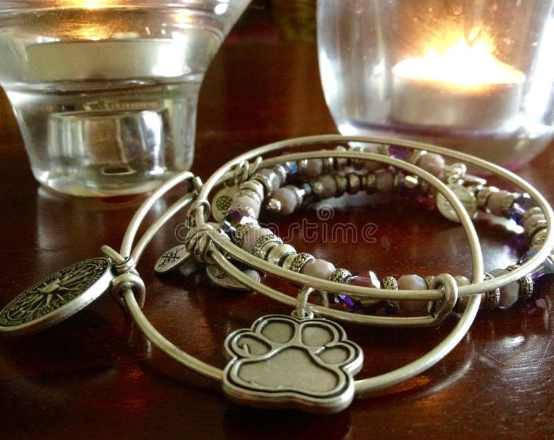 Unique handcrafted silver bracelets charms, crystals royalty free stock image