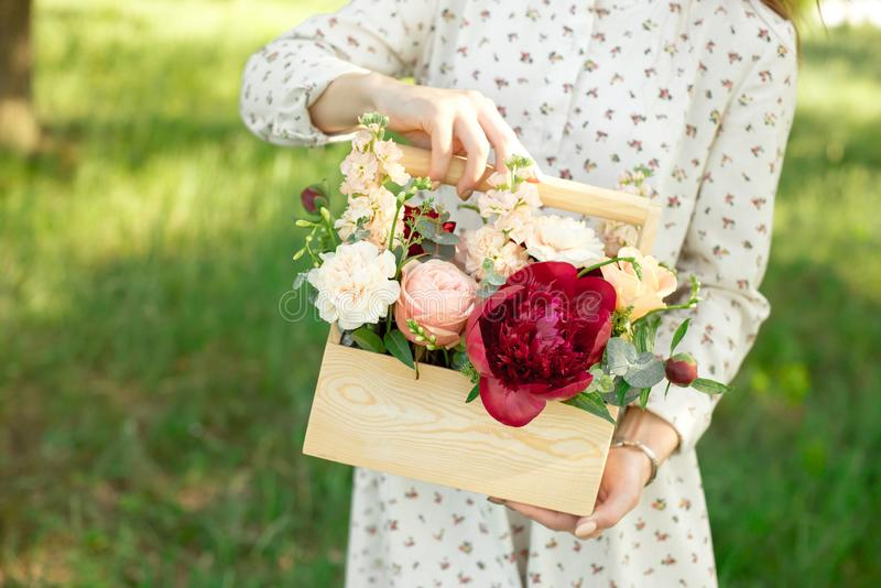 Unique handmade gift made from peach roses, peonies, red roses, packed in a wooden box royalty free stock images