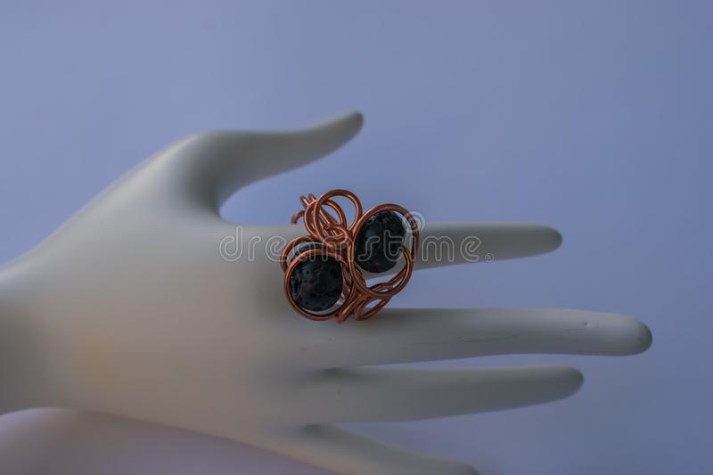 Unique handmade jewelry made of copper wire and colourful stones royalty free stock photography
