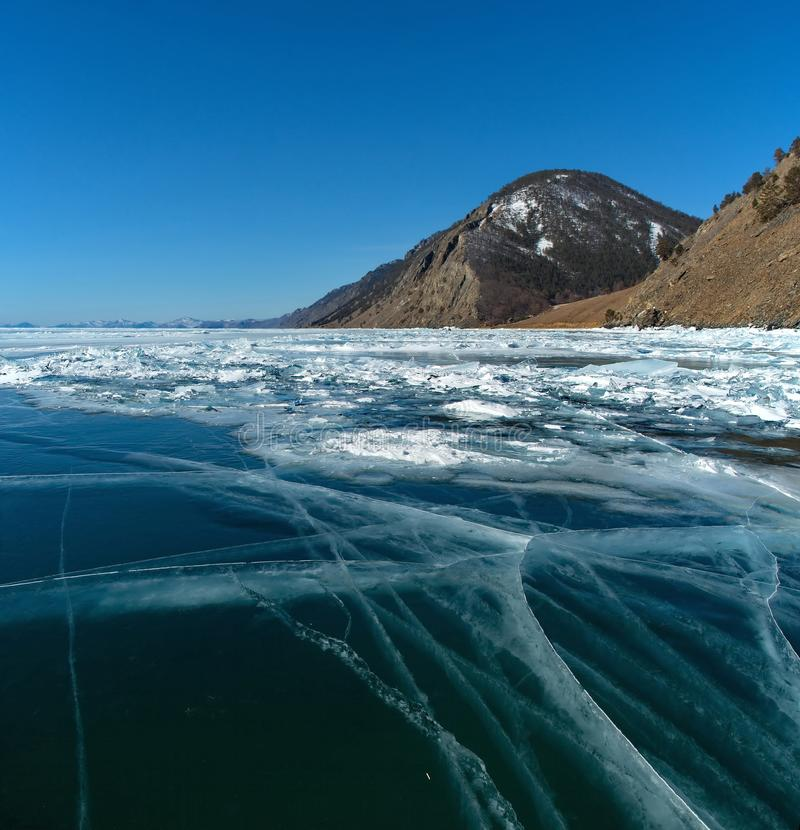 The unique ice lake Baikal. Russia. The Eastern Siberia. Amazing the transparency of the ice of lake Baikal due to the lack of snow and extreme cold in the stock image