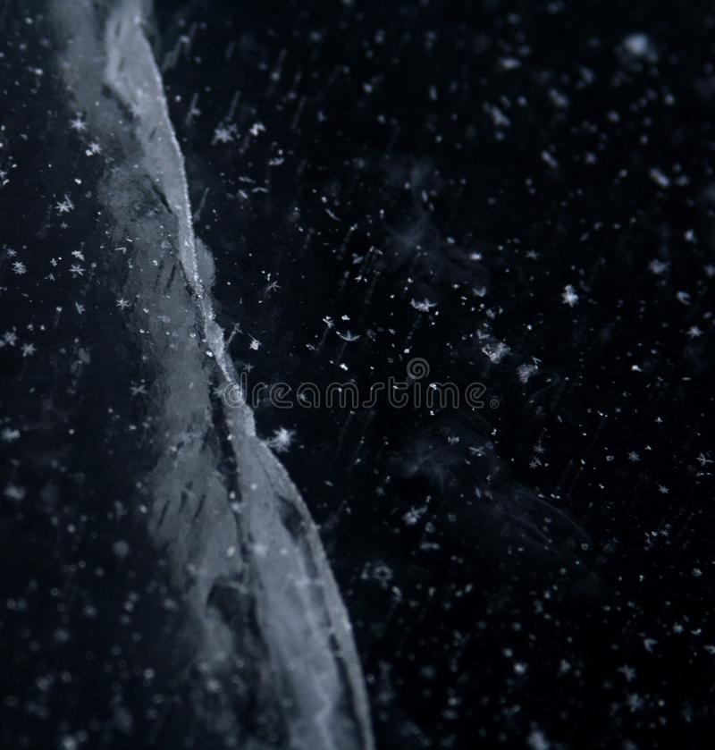 A unique image of ice resembling the stars and galaxies. Savonlinna Finland royalty free stock image
