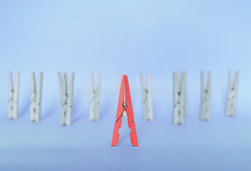 Unique, individuality, outstanding,leadership and think different concept. Red wooden clip stand out royalty free stock image