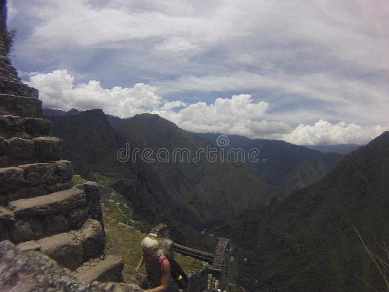 A unique and interesting view of the ancient Inca site of Machu Picchu, nestled high in the Andes Mountains of Peru. Background, beautiful, city, civilization royalty free stock photo