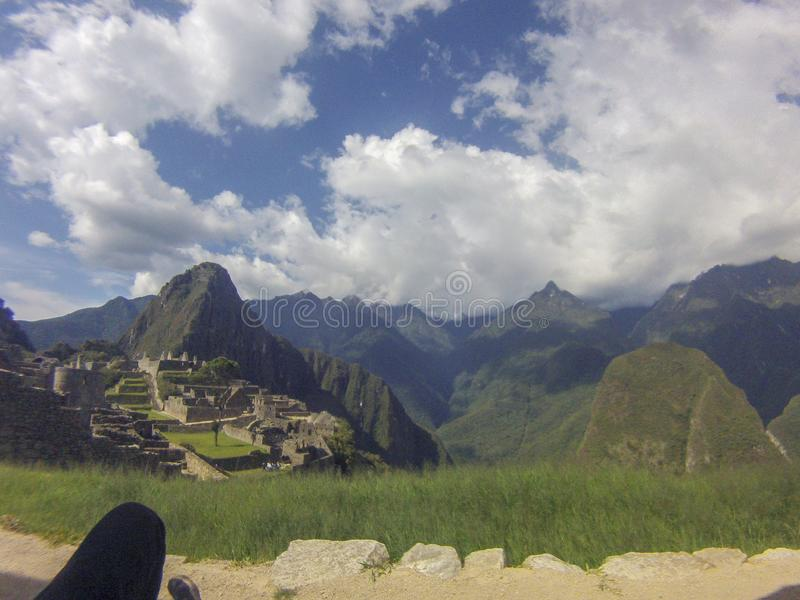A unique and interesting view of the ancient Inca site of Machu Picchu, nestled high in the Andes Mountains of Peru. Background, beautiful, city, civilization stock photography