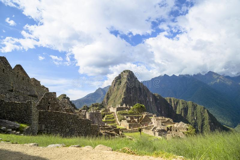 A unique and interesting view of the ancient Inca site of Machu Picchu, nestled high in the Andes Mountains of Peru. Background, beautiful, city, civilization royalty free stock image