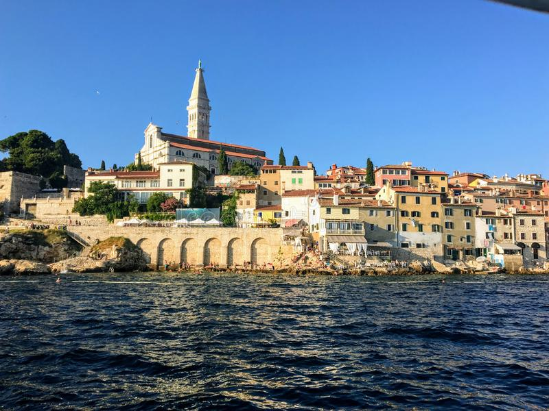 A unique and interesting view of the old town of Rovinj, Croatia with the clock tower in the background on beautiful summer day. Beautiful stock image