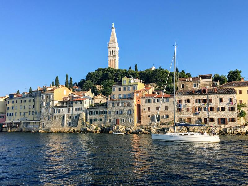 A unique and interesting view of the old town of Rovinj, Croatia with the clock tower in the background on beautiful summer day. Beautiful stock photography