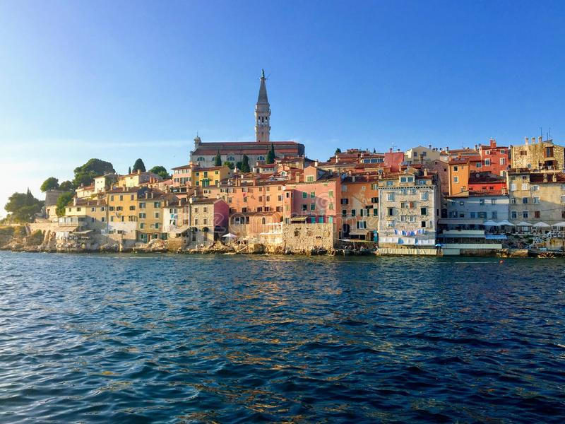 A unique and interesting view of the old town of Rovinj, Croatia with the clock tower in the background on beautiful summer day. Beautiful stock images