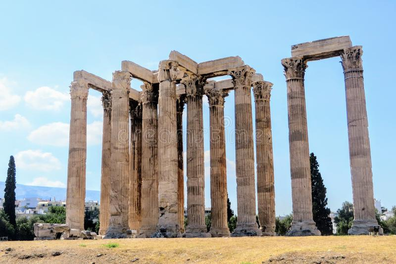 A unique and interesting view of the Temple of Olympian Zeus in Athens, Greece.  The temple is in full view with no people. It is a perfect summer day with royalty free stock photos