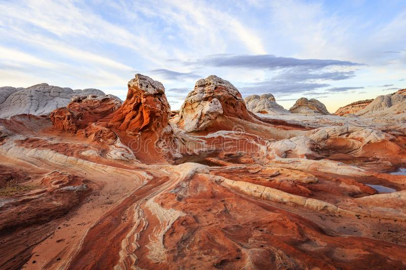 Unique badlands in the Utah desert, USA. Unique lightning in the Utah desert at dusk with glowing light, USA stock image