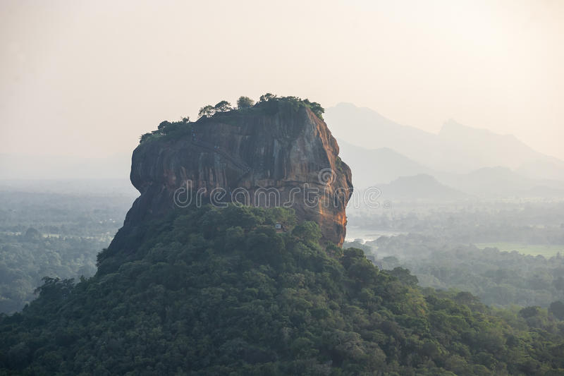 Unique Lion Rock in Sigiriya, Sri Lanka. Sunset over the Lion Rock in Sigiriya, Sri Lanka. Aerial view of the tropical forest with mountains royalty free stock photography