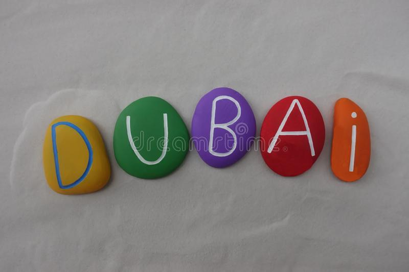 Dubai, United Arab Emirates, souvenir with a multi colored stones composition over white sand stock photography