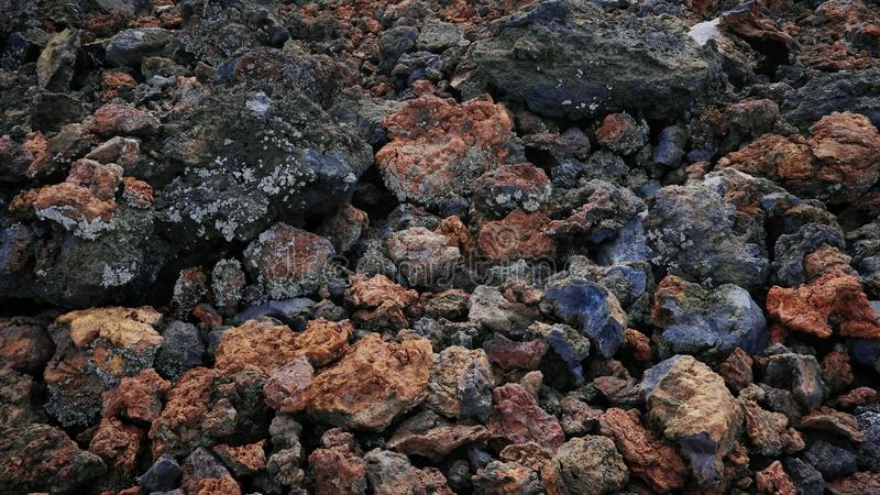 Mineral background of aa type lava created by the last volcanic eruption of Chinyero, Tenerife, Canary Islands, Spain. Unique mineral background of aa type lava royalty free stock photography