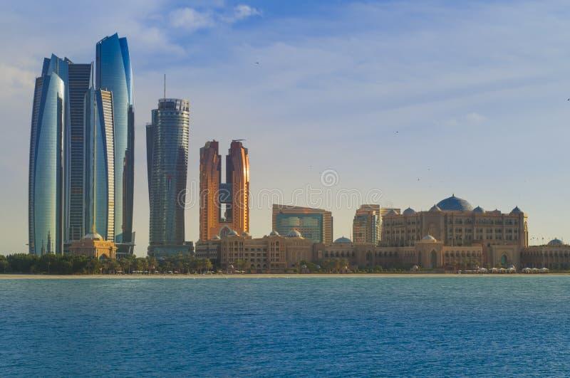 Unique modern Abu Dhabi skyline United Arab Emirates. Extreme architecture of Abu Dhabi UAE. Emirates Palace on the water stock photography