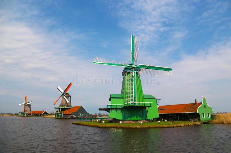 Unique, old, authentic, traditional and colorful dutch windmills along the canal of The Netherlands stock photography