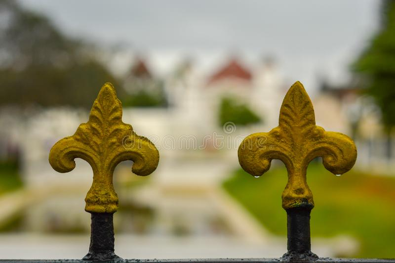 Unique ornaments on an iron fence in a garden, close-up and blurry background royalty free stock photos