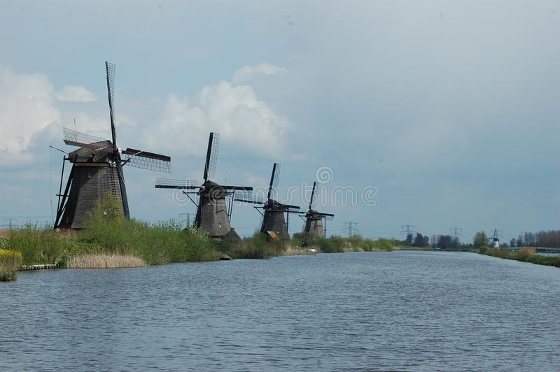 Unique panoramic view on windmills in Kinderdijk, Holland royalty free stock photography